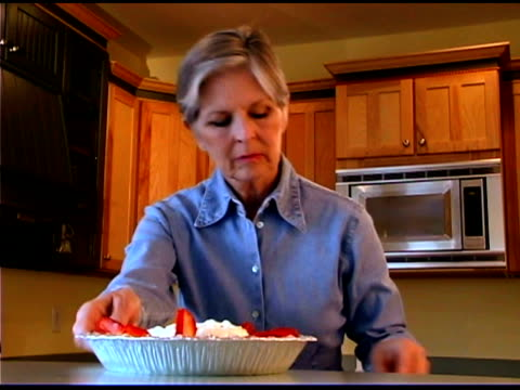 woman baking strawberry pie - bald head island stock videos and b-roll footage