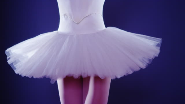 woman ballet dancer turning around while standing on tiptoes - tutu stock videos and b-roll footage