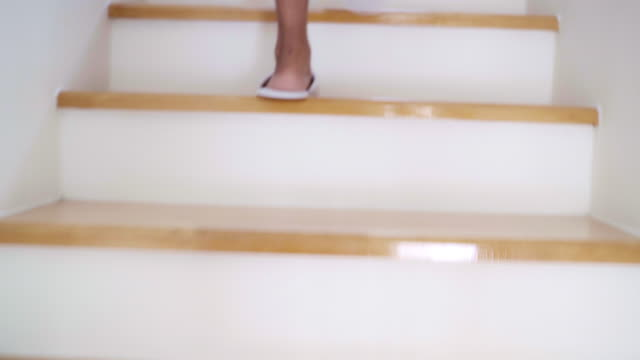 woman barefoot step walking up stairs in home. - steps and staircases stock videos & royalty-free footage