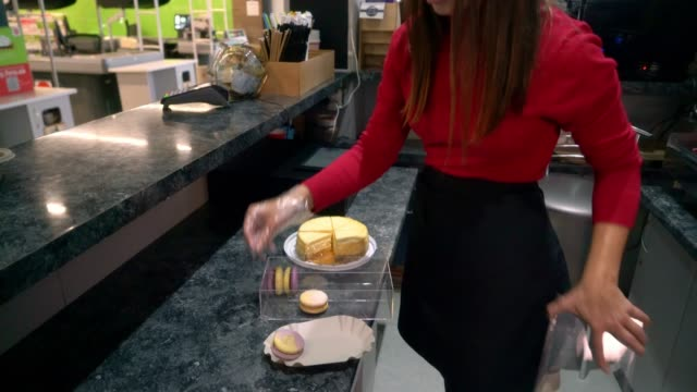 woman barista serving cake to a customer - macaroon stock videos & royalty-free footage