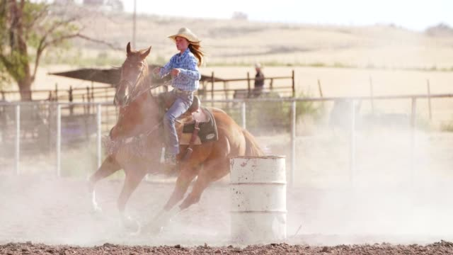 woman barrel racing at rodeo. - appaloosa stock videos and b-roll footage