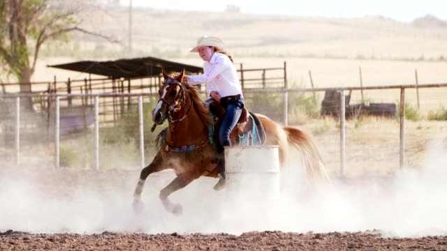 woman barrel racing at rodeo. - recreational horseback riding stock videos & royalty-free footage