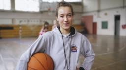 Woman basketball coach on training