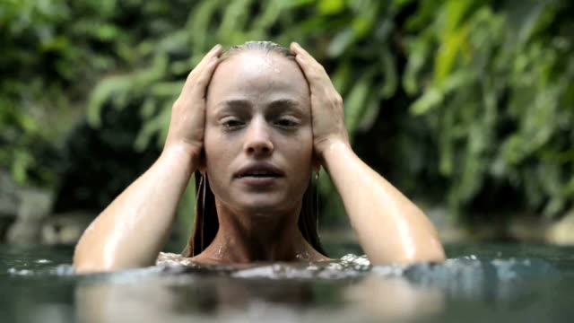 woman bathing in a natural pool - wet stock videos & royalty-free footage