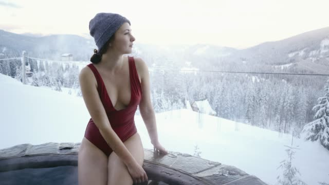 woman bathing in hot outdoors bathroom in winter - hot spring stock videos & royalty-free footage
