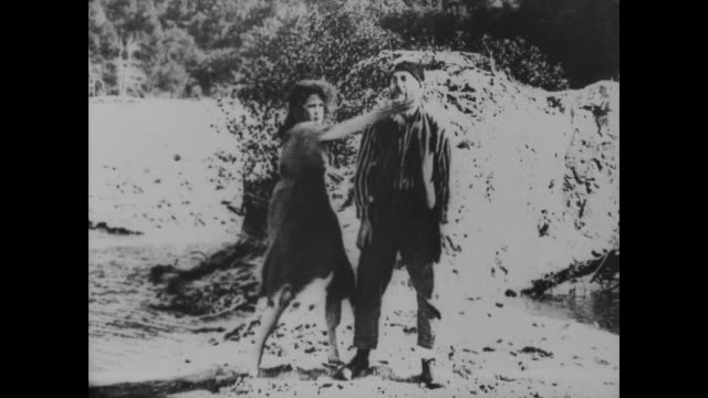 1918 woman beats up man - kicking stock videos & royalty-free footage