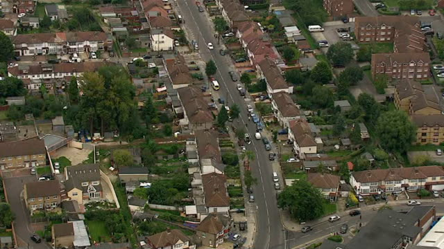 Woman beheaded in back garden in Edmonton Aerials ENGLAND London Edmonton of crime scene including houses police officers police vehicles forensic...