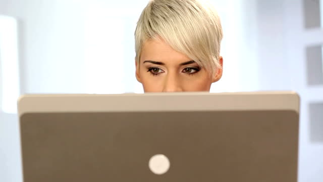 woman behind a laptop - behind stock videos & royalty-free footage