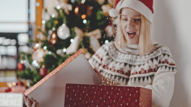 slo mo woman being ecstatic after opening her christmas present - 1 minute or greater stock videos & royalty-free footage