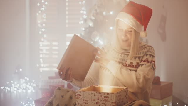 ds woman being excited while opening her christmas present - christmas gift stock videos & royalty-free footage