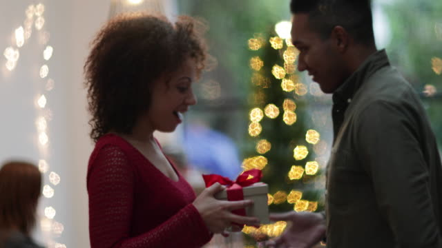 woman being given christmas gift - red stock videos & royalty-free footage
