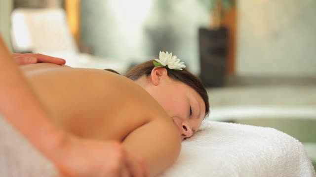 woman being massaged carefully - マッサージ台点の映像素材/bロール