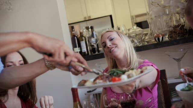 woman being served food at a dinner party - serving food and drinks stock videos and b-roll footage