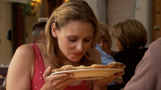 a woman being served outdoors at a restaurant - see other clips from this shoot 1150 stock videos and b-roll footage