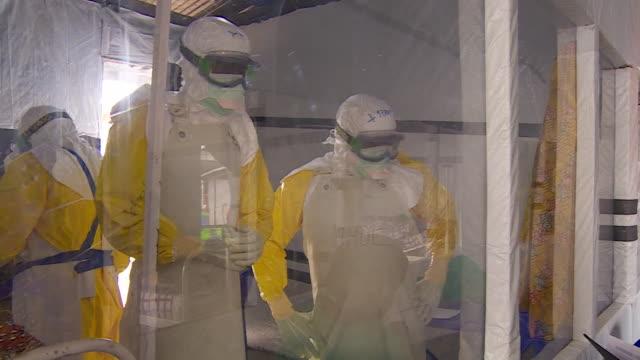 vídeos de stock, filmes e b-roll de woman being treated for ebola in ebola treatment centre in beni democratic republic of congo - ébola