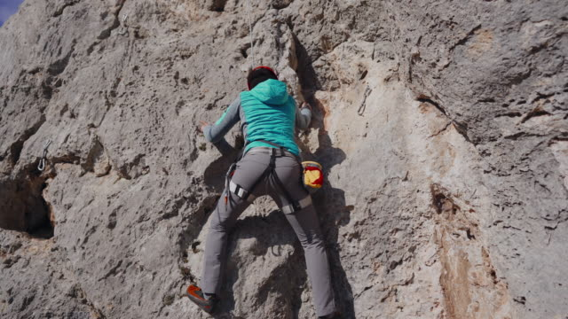 woman belaying from the cliff - belaying stock videos & royalty-free footage