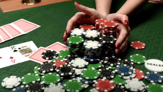 hd: frau wahl alle chips in poker-spiel - casino stock-videos und b-roll-filmmaterial