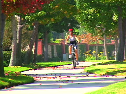 woman biking - one mature woman only stock videos & royalty-free footage