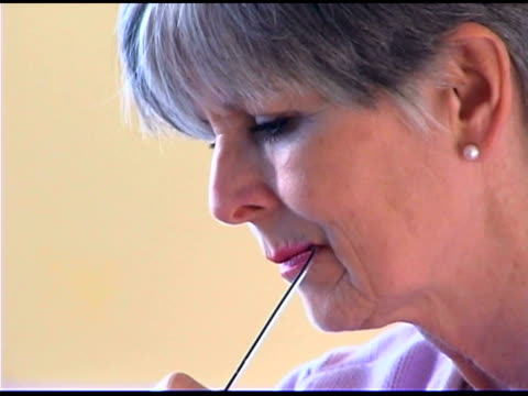 woman biting glasses - reading glasses stock videos & royalty-free footage