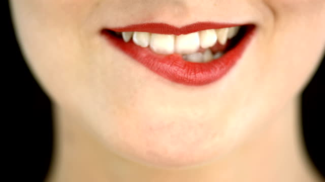stockvideo's en b-roll-footage met hd: woman biting her lip - menselijke lippen