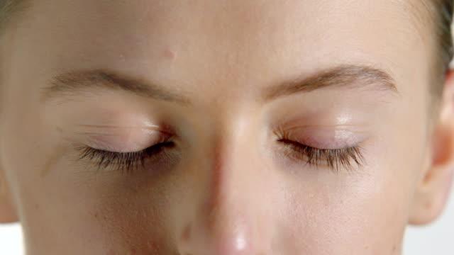 Woman blinking eyes
