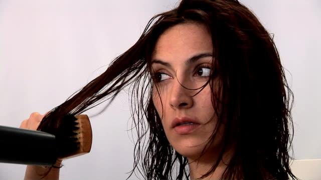 Woman blow drying hair
