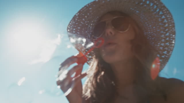 woman blowing bubbles - soap sud stock videos & royalty-free footage