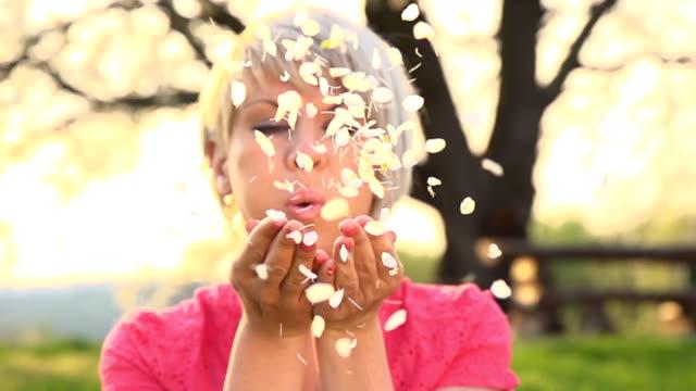 HD SUPER SLOW MO: Woman Blowing Flower Petals