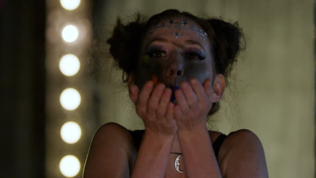 woman blowing glitter - cabaret stock videos & royalty-free footage