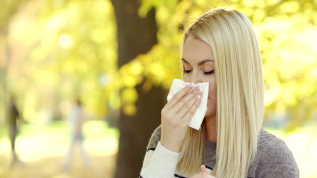 woman blowing her nose - sneezing stock videos & royalty-free footage