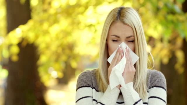 woman blowing her nose - hay fever stock videos and b-roll footage