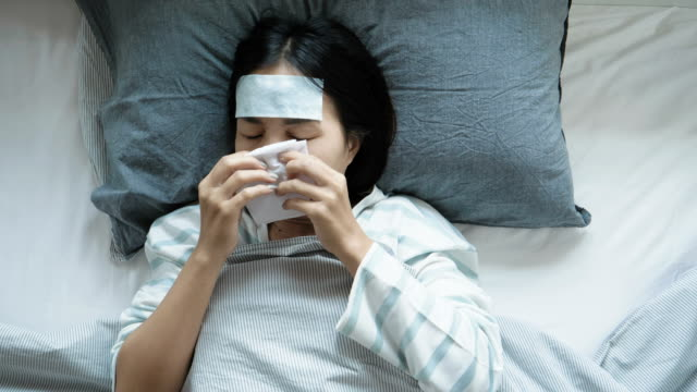 woman blowing nose into tissue - hay fever stock videos and b-roll footage