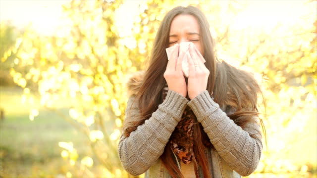 woman blowing nose - allergy stock videos & royalty-free footage
