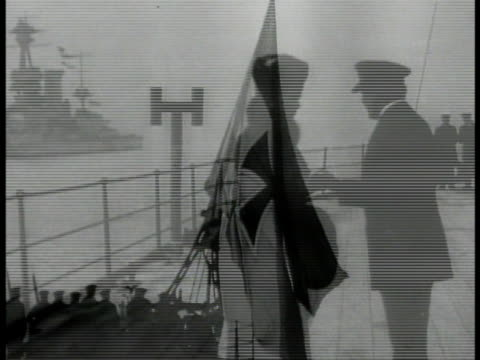 woman boarding english ship la ms german flag ws surrendered uboat submarines in harbor ws soldiers in formation on deck officer saluting german flag... - german flag stock videos & royalty-free footage