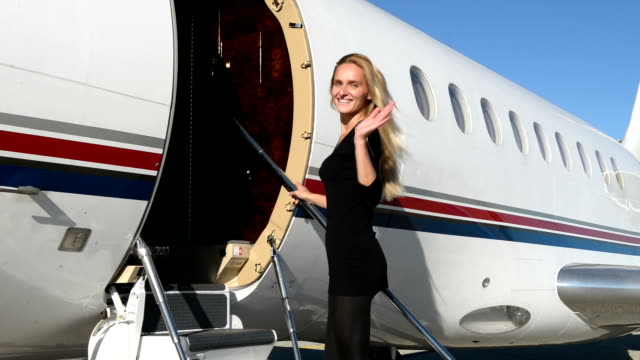 Woman boarding on private jet