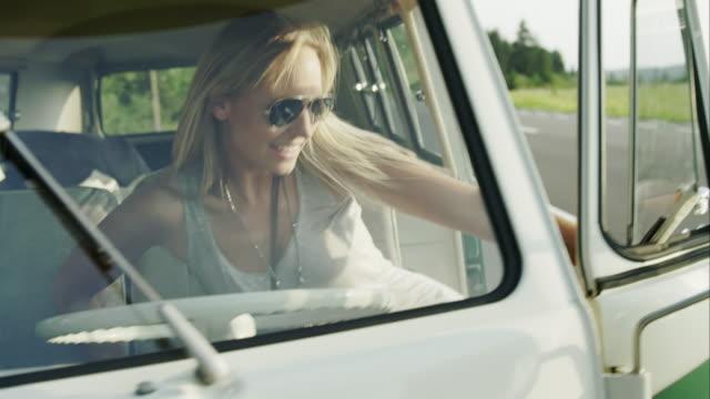 woman boarding van - getting on stock videos & royalty-free footage