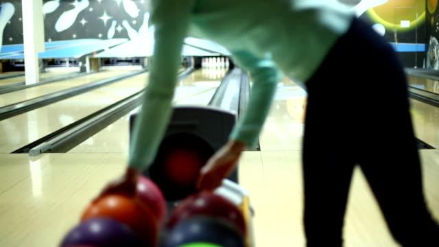 Woman bowling.