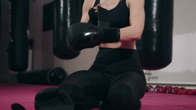 woman boxer putting on boxing gloves - kickboxing stock videos & royalty-free footage