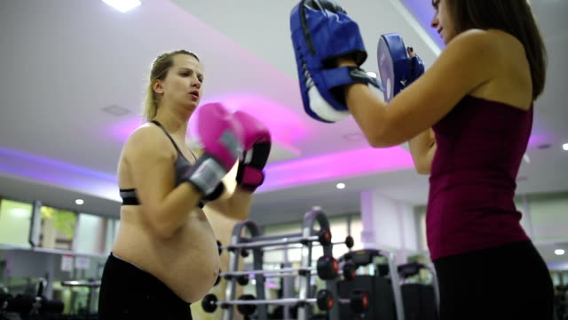 woman boxing during pregnancy - head back stock videos & royalty-free footage