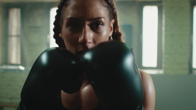 woman boxing punshing bag - punch bag stock videos & royalty-free footage
