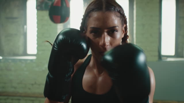 woman boxing punshing bag - sportsperson stock videos & royalty-free footage