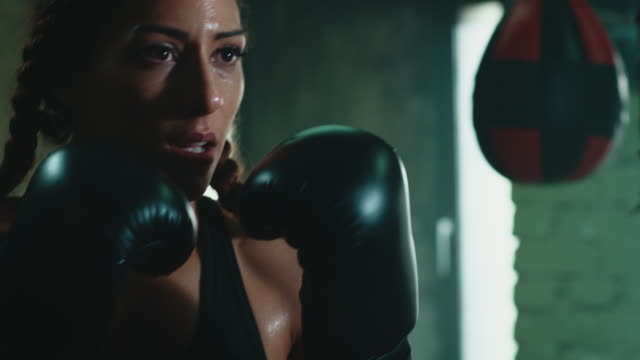 woman boxing punshing bag - toughness stock videos and b-roll footage