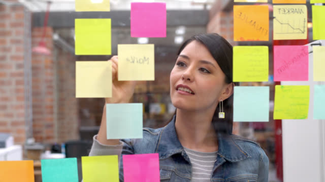 woman brainstorming at a creative office - adhesive note stock videos & royalty-free footage