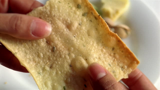 ecu slo mo woman braking bread, placing on plate - cracker stock videos and b-roll footage