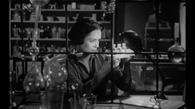 1959 woman (susan cabot) breaks into laboratory and injects stolen serum into her arm - injecting stock videos & royalty-free footage