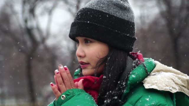 woman breathing on her hands to keep them warm in winter - shivering stock videos & royalty-free footage