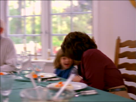 pan woman bringing turkey on platter to family seated at dining room table - roast turkey stock videos & royalty-free footage