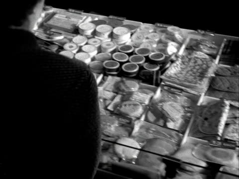 a woman browses the cosmetics counter in a shop 1955 - cosmetics stock videos & royalty-free footage