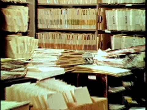 1970 MONTAGE Woman browsing files at property tax assessors, Los Angeles, California, USA, AUDIO
