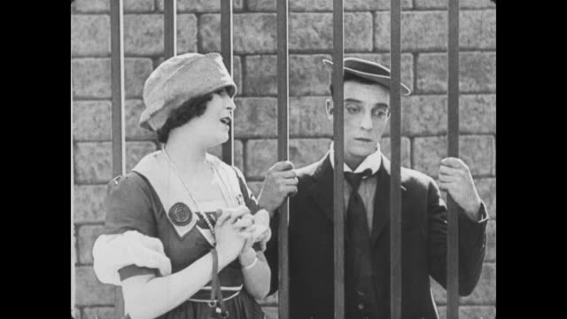 1922 woman (virginia fox) brushes off man (buster keaton) before estate gates - relationship breakup stock videos & royalty-free footage